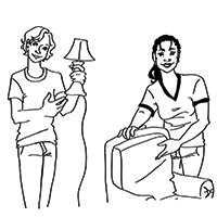 caitlin holding lamp and Amanda pointing to chair